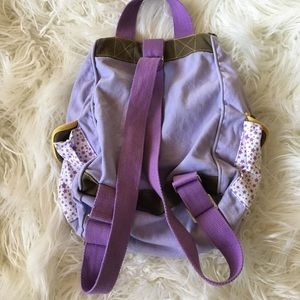 a73fda09ad Converse Bags - Converse Purple Yellow Star Print Mini Backpack